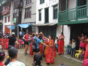 The Girls dancing in the streets of Okhaldhunga.