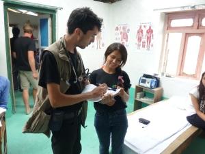 Jason and interpreter Manzuu discuss a patient at the MCHC