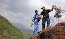 BPM volunteer Anthony Gadenne shows KRT Team Leader Uttam Koirala through the ropes.